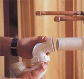Plumber in Newcastle fixing pipe